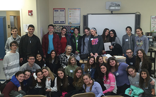 Holocaust survivor Edith Reich, surrounded by J-Serve teens, told them about her experiences and the importance of helping others. Photo courtesy Jewish Federation in the Heart of NJ