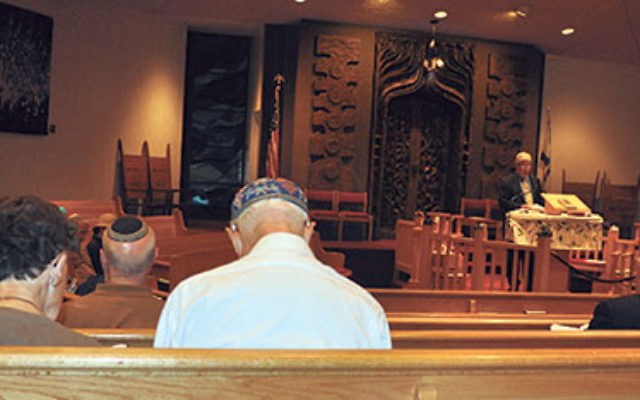 Rabbi Adam Feldman spoke about murdered Israeli teenagers at an evening service held in their memory.