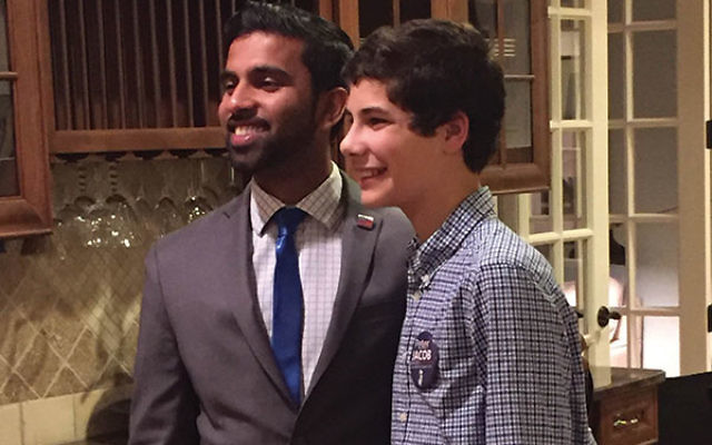 Jonah Altmann greets candidate Peter Jacob at a fund-raiser hosted by the teen in his Westfield home.