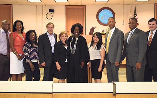 Israeli Judge Nira Duskin, sixth from left, meets with Newark officials, from left, court attendant Ronald C. High; public defenders Ashlie Gibbons and Cassandre Lamarre; Municipal Court administrator Yvonne Bowers; Duskin's husband, Zvi; Chief Judg