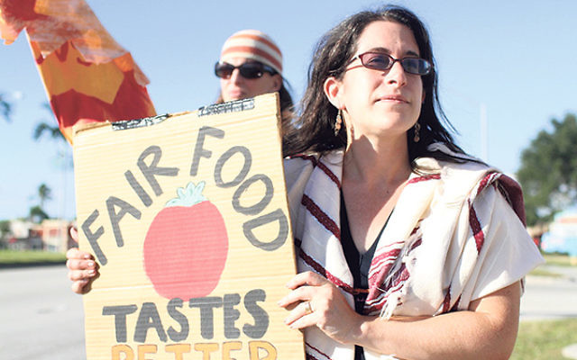 """Rabbi Rachel Khan-Troster protests on behalf of tomato pickers in Florida, who she said deserve the support of the Jewish community in their efforts to be paid a """"dignified"""" wage."""