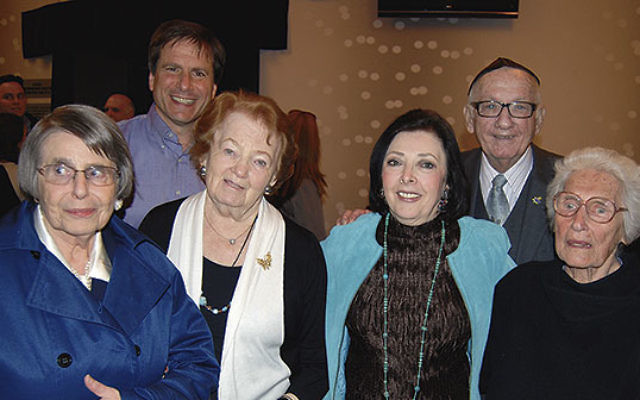 At the Yom Hashoa commemoration at Kean University are honoree Dr. Paul Winkler, right, Barbara Wind, second from right, and, from left, survivors Gerda Bikales (with her son Eddy behind her), Marsha Kreuzman, and Anitta Fox.