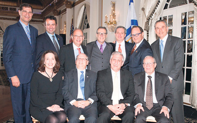Guests of honor Max Kleinman, seated, center, left, and David Lentz, center, right, are flanked by Leslie Dannin Rosenthal, president, Jewish Federation of Greater MetroWest NJ; Izzy Tapoohi, Israel Bonds president & CEO and, standing, from left, Larr