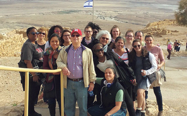 Max Kleinman led 15 students on a trip to the Negev as part of two weeks of study in Israel. Marianne Fontillas is at Kleinman's right; Sheree Boone is third from left in the third row, just behind Fontillas.