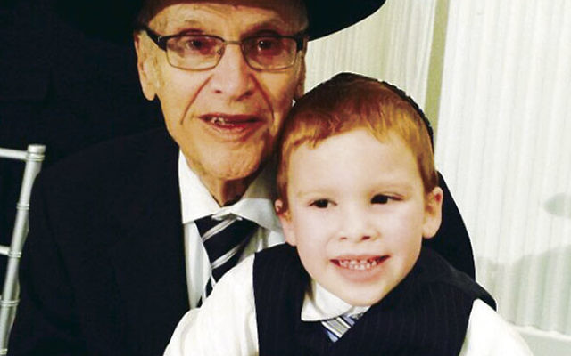 Rabbi Meyer Korbman, shown with a great-grandson