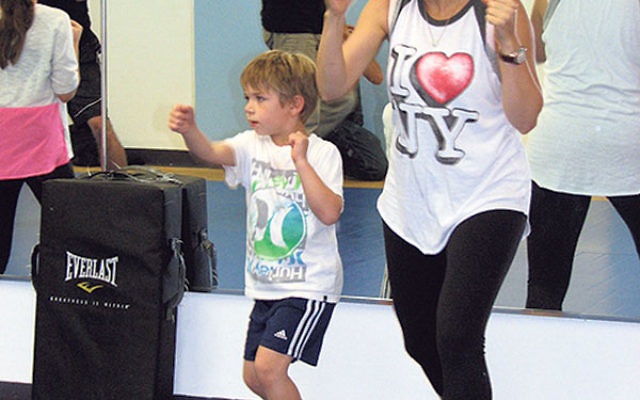 At the Do-Re-Mi School of Music & the Arts, Jane Sambol of Livingston and her son have fun while they practice Krav Maga moves.