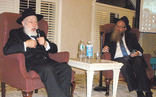 Rabbi Yehuda Krinsky, left, former secretary to the Lubavitcher Rebbe, said he feels the thousands of Chabad emissaries worldwide are extensions of the Rebbe; he was interviewed by Chabad of Western Monmouth County's Rabbi Boruch Chazanow. &nb