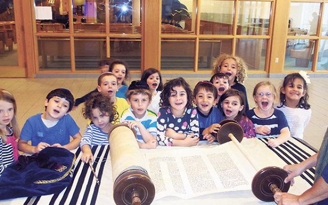 Joseph Kushner Hebrew Academy elementary school students get a look at the Torah scroll