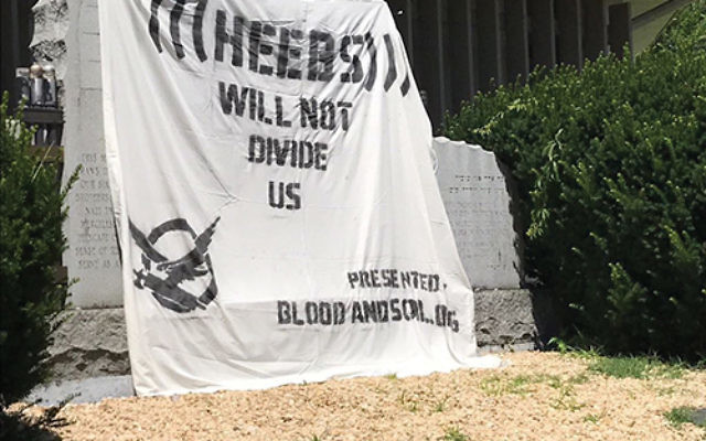 An anti-Semitic banner covered a Holocaust memorial at Congregation Sons of Israel in Lakewood. Photo courtesy The Lakewood Scoop