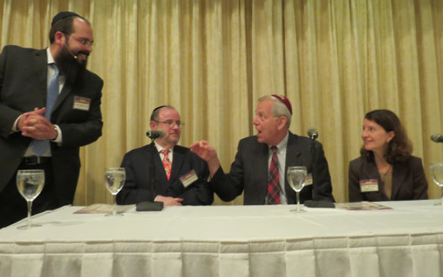 Rabbi Shalom Lubin, left, leader of Chabad of SE Morris County, throws ethical questions at, from left, Rabbi Michael Broyde, Dr. Kenneth Prager, and Sharona Hoffman.