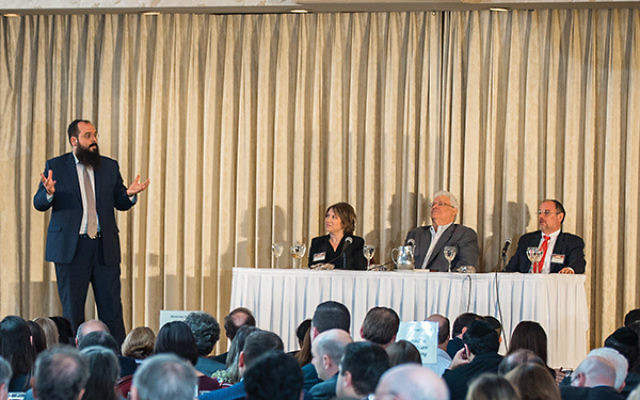 Rabbi Shalom Lubin moderates a panel at the Jewish Law Symposium featuring, from left, Francine Halushka Katz, Arthur Caplan, and Rabbi Michael Broyde. Photo by Mendy Moscowitz