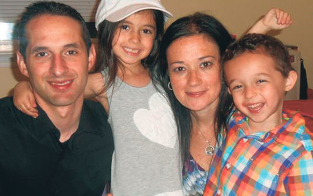 Darren Lederman with his wife, Stacey, and their children, Emma and Noah.