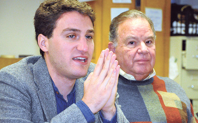 Jacob Levkowicz, left, addresses the gathering as Herb Horowitz, past president of the AJC Central NJ chapter, listens.
