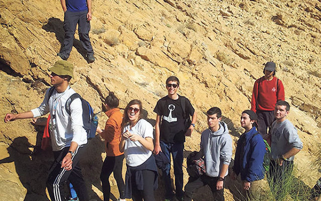 Jacob Lichtblau, center, in black with sunglasses, hiking with fellow Young Judaea Year Course students near Sde Boker in the Negev.