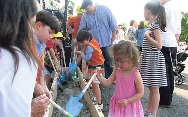 Even the smallest participants had the opportunity to mix cement for laying the cornerstone of LifeTown.
