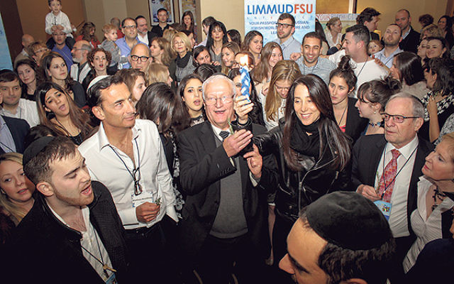 Limmud participants take part in a Havdala ceremony.