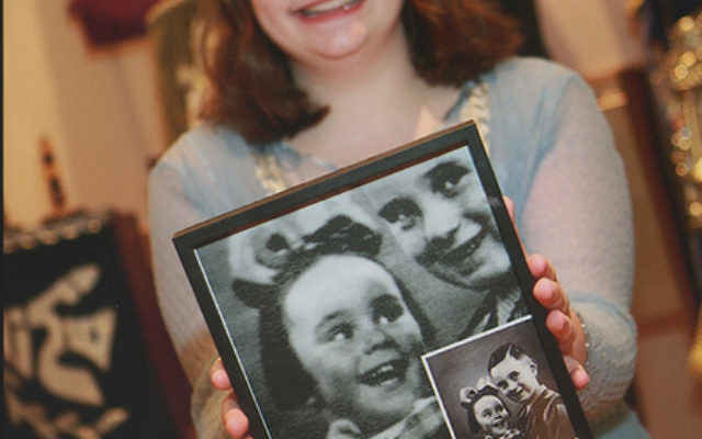 Ariella Livstone, who celebrated her bat mitzvah in March, holds a photo of Lucie Lipstein, a Belgian child murdered in Auschwitz who was paired with Ariella by the Remember a Child project of The Generation After. Photo by Barry Korbman