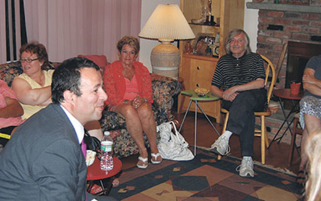 Parents involved in the new local chapter of the Lone Soldier Center meet in a Livingston home to hear Dov Ben-Shimon, the new head of the GMW NJ federation, a former lone soldier himself.