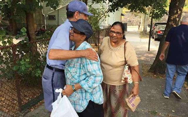 Arthur Jackson says goodbye to residents in Jersey City. In 35 years as a letter carrier, his customers became family.