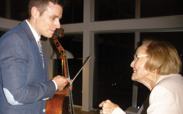 Longtime community philanthropist Ruth Hyman of Long Branch chats with musician Elad Kabilio after the performance by his group, Music Talks.
