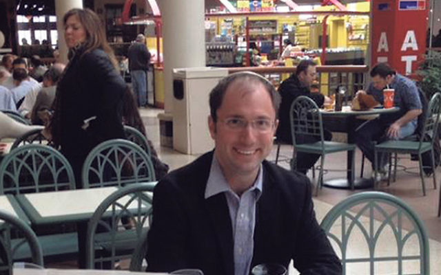 Rabbi Ari Saks at his weekly table in the food court at the Menlo Park Mall has fielded questions and had discussions with both Jews and non-Jews on Israel, intermarriage, and Judaism.