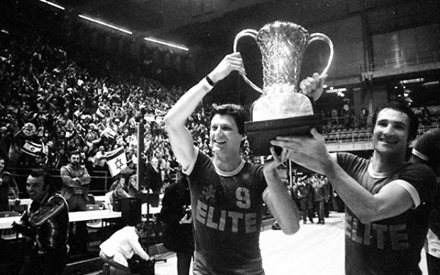 Tal Brody, right, celebrates with the European Basketball Championship trophy following Maccabi Tel Aviv's win over the Red Army.