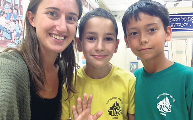 """Lindsey Skerker in a """"selfie"""" with two students in one of her English classes in Netanya."""
