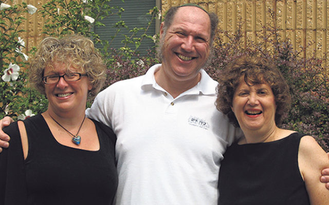 Linda Meisel, right, joins with Anne Berman-Waldorf and Rabbi Eric Wisnia of Congregation Beth Chaim in Princeton Junction in September 2008, at the launching of Promoting Healthy Families, an initiative of JFCS and the synagogue.