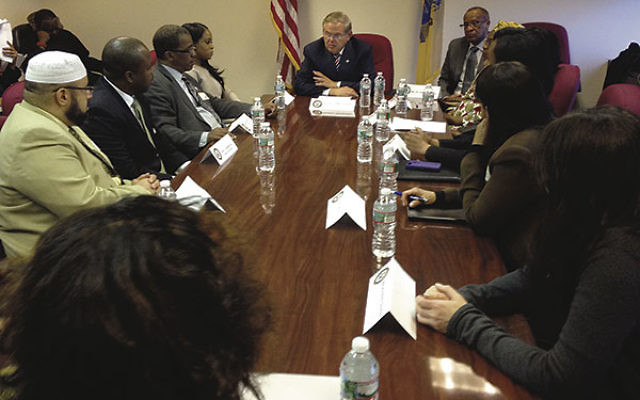 Sen. Robert Menendez briefs human rights experts and local community leaders on the kidnappings of hundreds of schoolgirls in Nigeria.