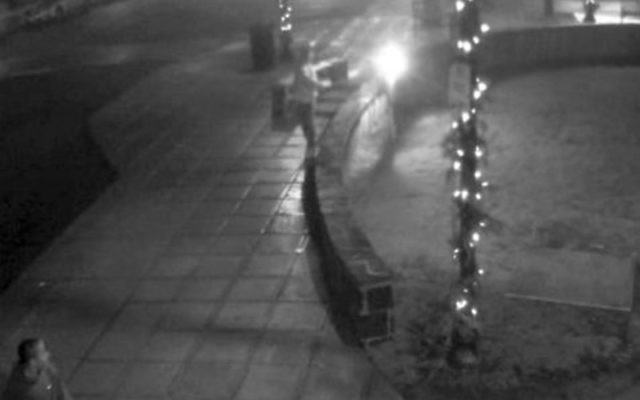 A still from the security footage released by the South Orange Police Department of one of the three suspected vandals.