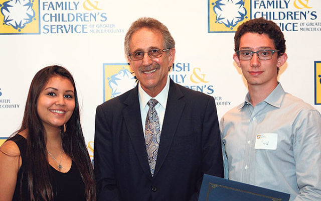 Mensch Award honorees Mia Reback and David Piegaro flank Marc Linowitz, president of the Rose & Louis H. Linowitz Charitable Foundation.