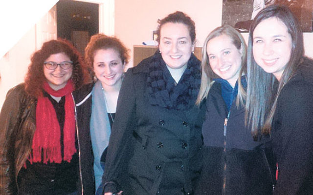 Gathering for wine and cheese and learning at the Morristown home of Lana Voskoboynik, far left, are, from left, Molly Sauer of Morristown, Leah Zilberman of Montclair, and Hillary Teichman and Sarah Teichman, both of West Orange.