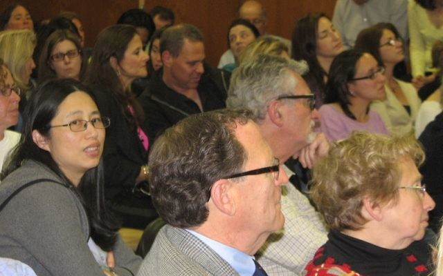 A diverse crowd of over 75 people attended the April 28 Millburn Township board of education meeting at the Education Building in Millburn.