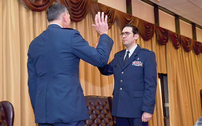 Col. Joseph Deichert administers the oath promoting Major Menashe Miller to lieutenant colonel. Photo courtesy of TheLakewoodScoop.com
