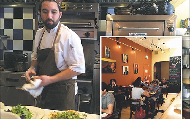 Diners dig in as chef Meny Vaknin works in the open kitchen at Mishmish.