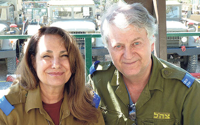 "Marion and Steve Mittelman on an IDF base in Israel; when serving with Volunteers for Israel, she said, ""the gratitude from Israelis is something. It's very powerful."""