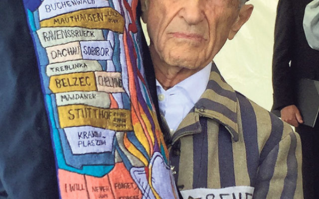 Holocaust survivor Ed Mosberg brought his own commemorative Torah to the 70th anniversary commemoration of the liberation of the Mauthausen concentration camp, held May 10.