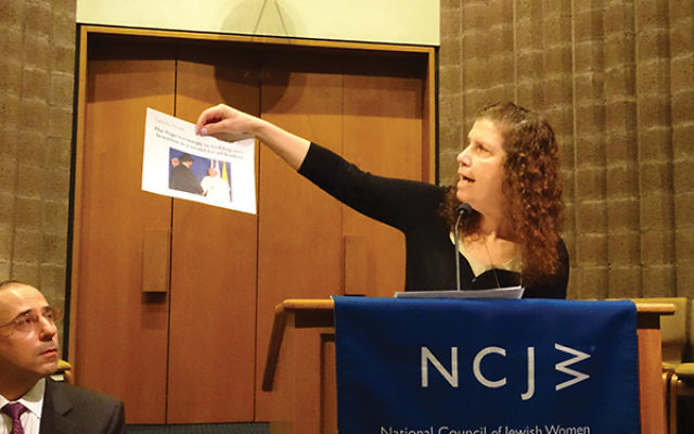 "Brandishing news articles about interfaith cooperation in the face of bias crime, Susan Werk, education director at Congregation Agudath Israel, said children should be exposed to ""positive stuff"" to teach them how to behave."