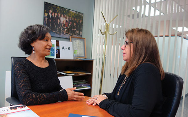 Aster Yilma, left, a client at the NCJW/Essex Center for Women, consults with career services manager Patty Kremen. Photos by Robert Wiener