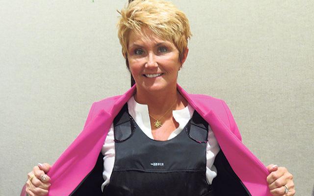 Clinton Mayor Janice Kovach shows a bulletproof vest like those worn by many fearful abortion providers.