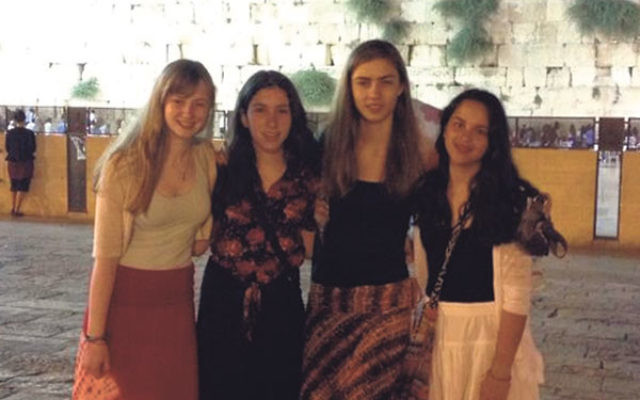 Trip participants, including Sophie Fox, far right, at the Kotel in Jerusalem.
