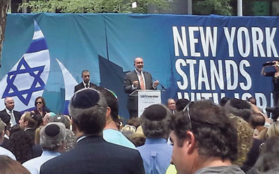 Israeli Ambassador to the UN Ron Prosor speaks to the 10,000 people gathered at the New York Stands with Israel Rally.