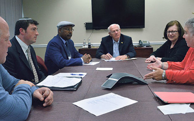 At a NJ State Association of Jewish Federations gathering at the JCC of Central NJ in Scotch Plains, Knesset Member Dr. Avraham Neguise, third from left, meets with leaders, from left, Bob Kuchner, a board member of the Jewish Agency for Israel and of the