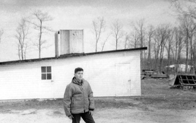 Michael Kirschenbaum in front of the brooder coop on the farm on Friendship Road in Howell, 1966.