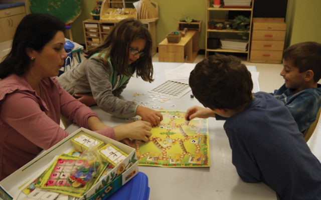 Playing board games is part of the Hebrew immersion program at Ofek.