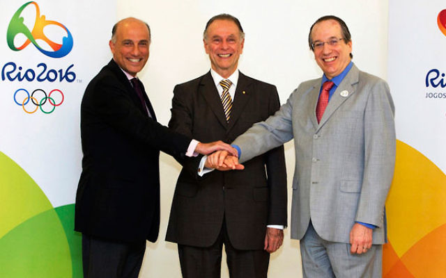 The Jewish trio in charge of the Rio Olympics: Carlos Arthur Nuzman is flanked by Sidney Levy, left, and Leonardo Gryner, Nov. 9, 2012. (Marcio Rodrigues)