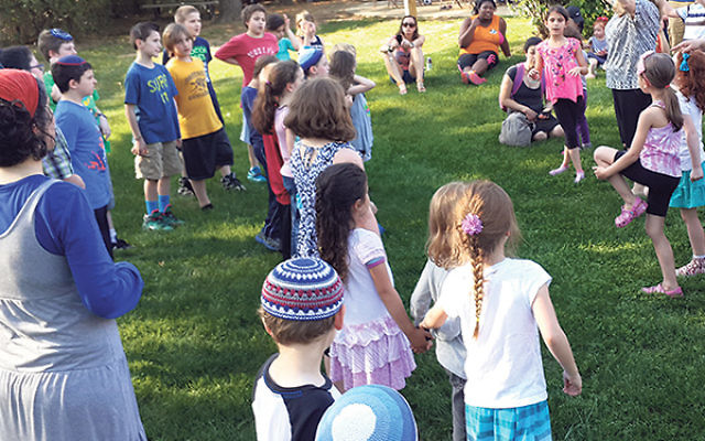 A Lag Ba'Omer PJ Library Barbecue last year — which featured a representative from the Nefesh Yehudi Academy and was aimed at Israeli-born adults with children — received a microgrant from the Middlesex federation, which cosponsored the