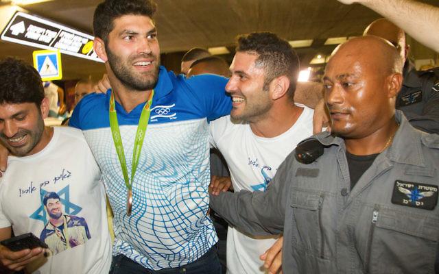 Israeli judoka Ori Sasson, second from left, arriving at Ben Gurion Airport near Tel Aviv, Aug. 15, 2016.