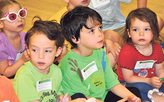 Children listen to a reading at the kick-off PJ Library event.