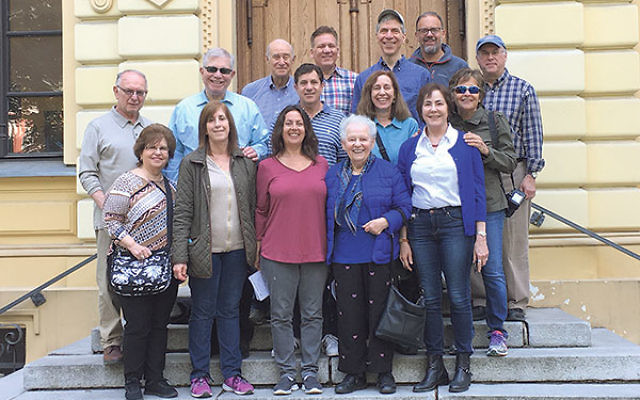 Mission members gather in front of the restored Nozyk Synagogue in Warsaw.